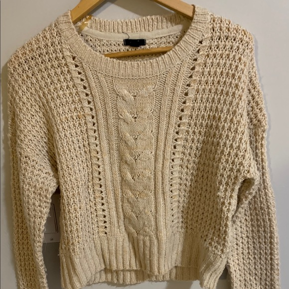 Yellow cable knot sweater